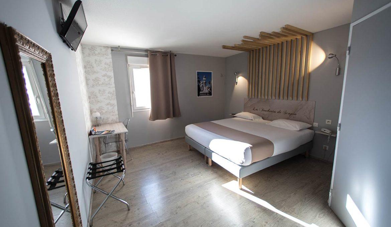 Un lit double à l'hôtel Grand Cap en Agde